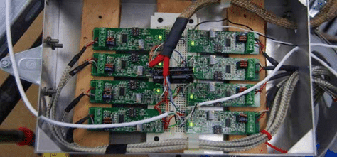 photo of amplifiers and strain gauges wired on a bread board